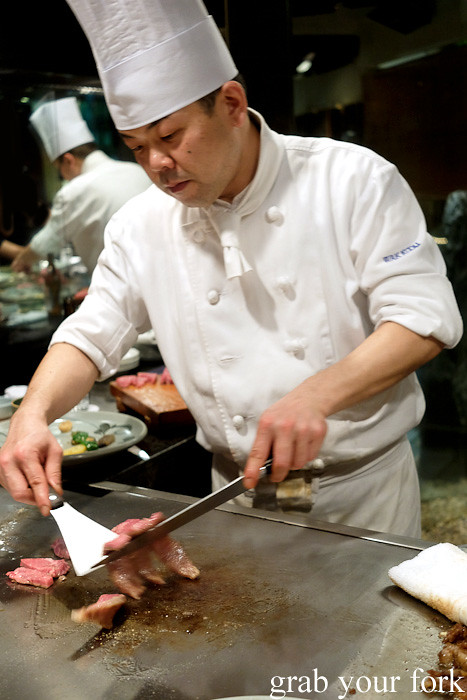 Flipping the seared Kobe wagyu beef sirloin at Wakkoqu, Kobe, Japan