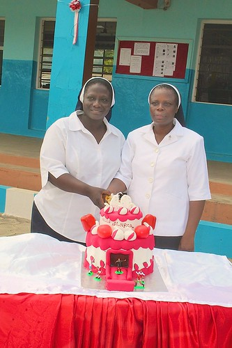 Sisters Cecilia Lengpang (left) and Mary Okewola (right) cutting the 40th anniversary cake