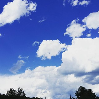 Fluffy white #clouds competing with the dark t-storm clouds at the track today... it's pretty for now! #sky #Maine #skyporn #skystagram #instasky #bluesky #summersky #summer