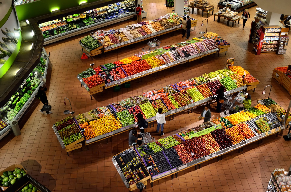 Consumers shopping for produce and fruit. in a supermarket