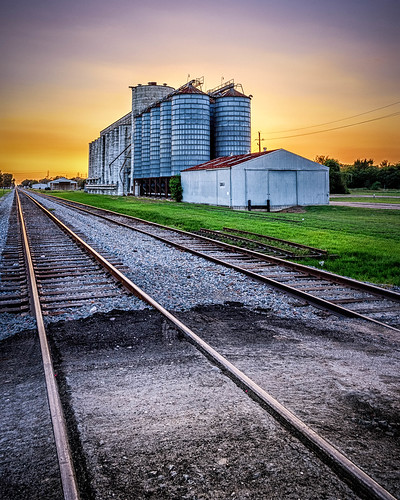 sunset grainelevator farming farm railway train rails grass houston texas sunsets dusk evening architecture building buildings grain