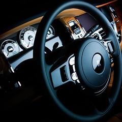 wheel(0.0), rim(0.0), automobile(1.0), rolls-royce wraith(1.0), vehicle(1.0), automotive design(1.0), steering wheel(1.0), land vehicle(1.0), luxury vehicle(1.0),