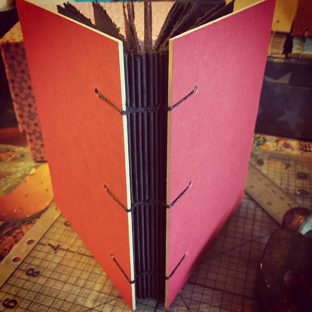 Coptic bound book with 90 lb black Stonehenge paper 6 1/2 x 5 inches #books #bookarts #bookbinding #copticbinding #exposedspinebindings #handmadebooks #handboundbooks