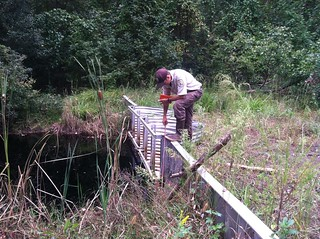 Fred Wurster, Hydrologist, manipulates a water control structure