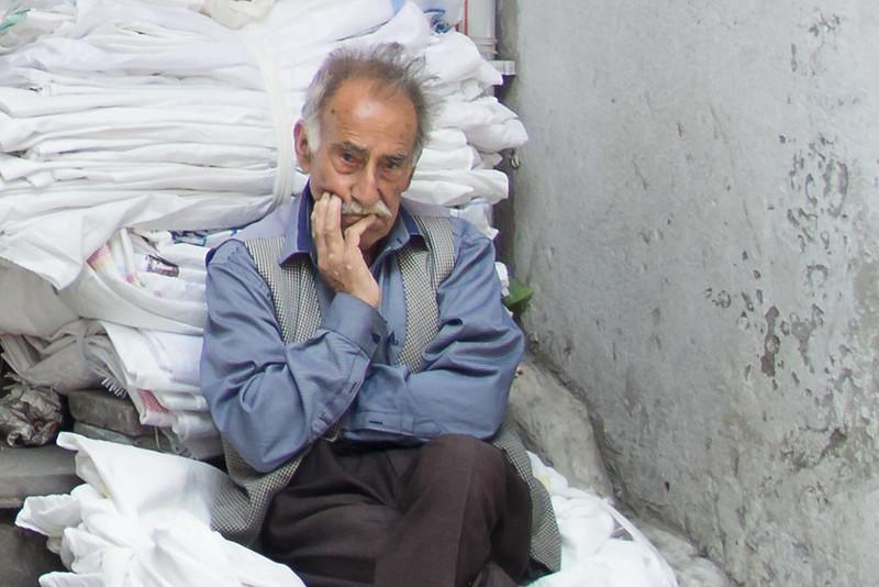 Bored Turk in Grand Bazaar, Istanbul, Turkey