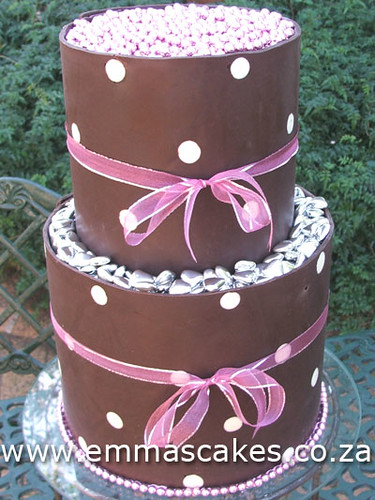 2 Tier tall wedding cake with dark chocolate polkadot band collars around