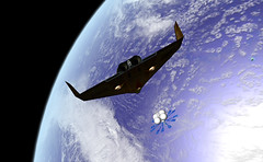extreme sport(0.0), screenshot(0.0), aircraft(1.0), aviation(1.0), spacecraft(1.0), wing(1.0), vehicle(1.0), space(1.0), earth(1.0), blue(1.0), outer space(1.0), flight(1.0),
