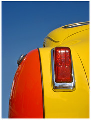 model car(0.0), bumper(0.0), automobile(1.0), orange(1.0), automotive tail & brake light(1.0), automotive exterior(1.0), yellow(1.0), vehicle(1.0),
