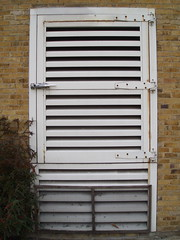 garage door(0.0), shutter(0.0), gate(0.0), window covering(0.0), interior design(0.0), door(0.0), wood(1.0), metal(1.0), iron(1.0),