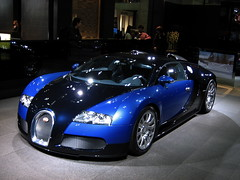 automobile(1.0), bugatti(1.0), wheel(1.0), vehicle(1.0), automotive design(1.0), auto show(1.0), bugatti veyron(1.0), land vehicle(1.0), luxury vehicle(1.0), supercar(1.0), sports car(1.0),