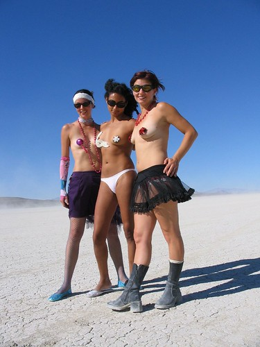 Three Ladies at Burning Man Donning Pasties