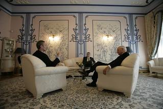 Vice President Cheney Talks with David Addington and John Hannah at the House of Chimeras in Kiev, Ukraine