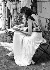 Lady in White Skirt Reading Newspaper