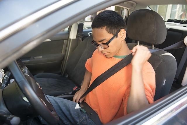 Teen fastening seat belt