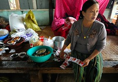 Madahya Kyaung monastery smart lady preparing food for monks