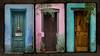 three barrio doors