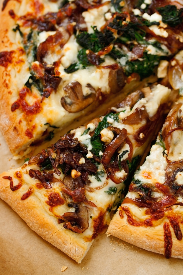 Caramelized Onion Feta Spinach Pizza with creamy white sauce! This pizza tastes like you ordered it at a fancy restaurant But it's simple to make at home! #pizza #caramelizedonions #spinachpizza #greekpizza | Littlespicejar.com @Littlespicejar