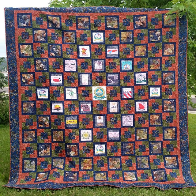 One last picture of the quilt before it heads to the convention.  Paul helped me hang it up.