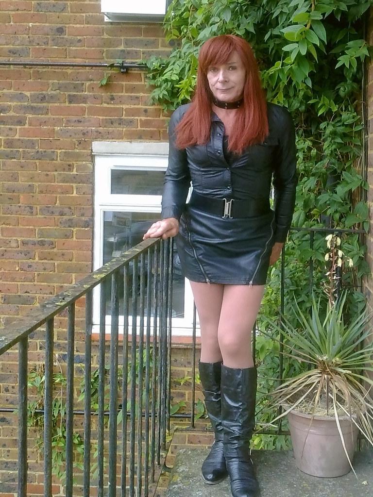 She was wearing leather dress leather mini dress leather mini