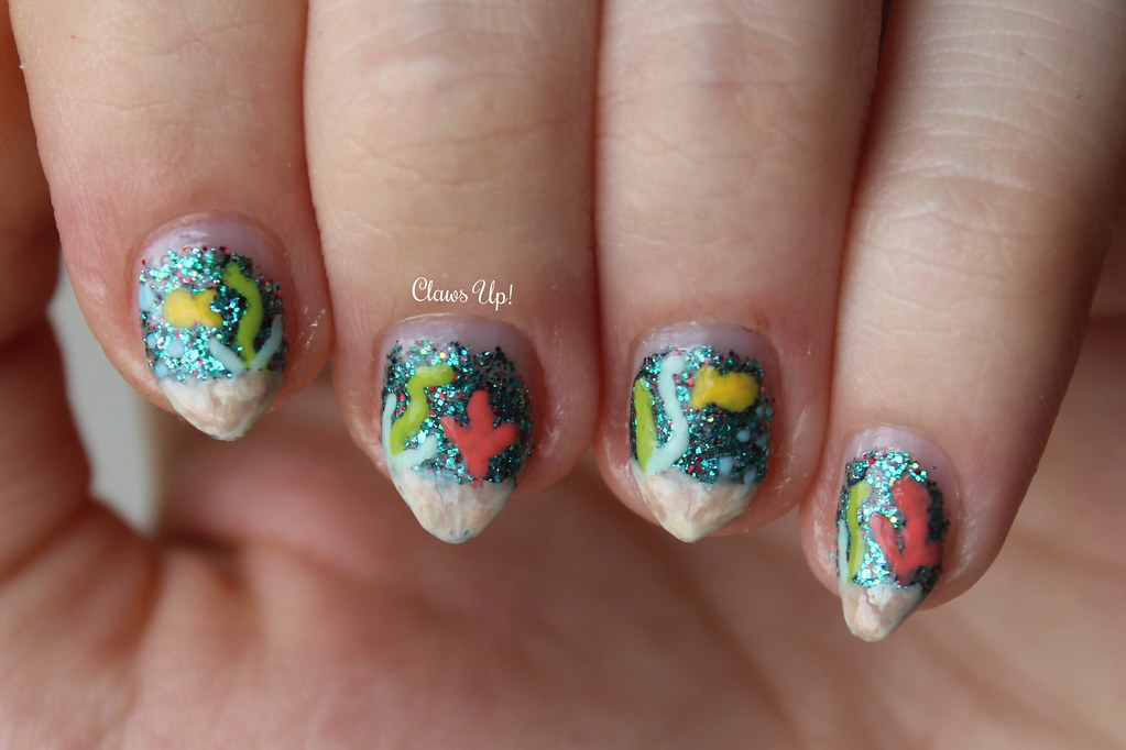 Under the sea glitter nail art