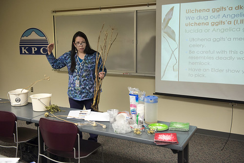Tia Holley talks about traditional uses for wild plants while presenting her final project in a Dena'ina language class at Kenai Peninsula College in December.