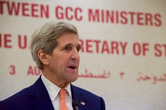 U.S. Secretary of State John Kerry addresses reporters at the Sheraton Hotel in Doha, Qatar, on August 3, 2015, during a news conference with Qatari Foreign Minister Khalid al-Attiyah after the Secretary briefed members of the Gulf Cooperation Council about the Iran nuclear deal. [State Department photo/ Public Domain]