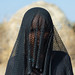 Portrait of an Afar tribe woman with her face covered with a veil to protect from the dust, Afar region, Chifra, Ethiopia by Eric Lafforgue
