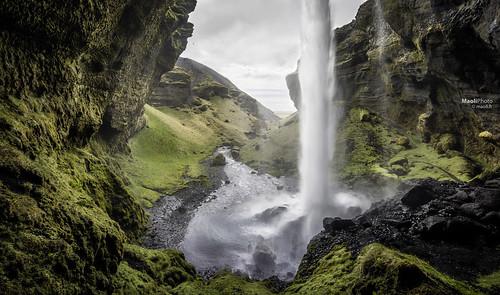 travel mountain water dark landscape waterfall iceland moody outdoor cliffs cave morose torrent kvernufoss