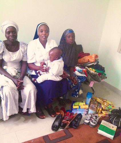 Jacinta Otene SSL with Sofiat (on her left), her mother and brother.