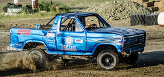 auto racing(0.0), sport utility vehicle(0.0), monster truck(0.0), automobile(1.0), racing(1.0), pickup truck(1.0), vehicle(1.0), truck(1.0), sports(1.0), off road racing(1.0), off-roading(1.0), rally raid(1.0), off-road vehicle(1.0), ford(1.0), mud(1.0), land vehicle(1.0),