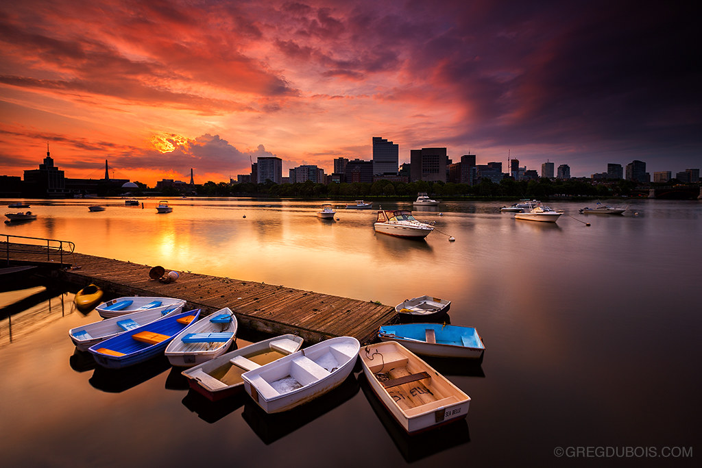 Dinghies on Charles River with Boston Skyline Silhouette, Fiery Sunrise with Moored Yachts from Cambridge Massachusetts USA