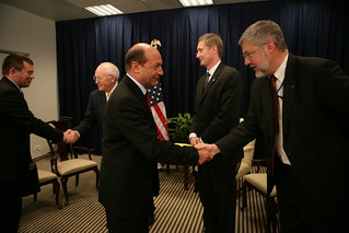 David Addington Greets President Băsescu of Romania While Vice President Cheney and John Hannah Stand in the Background in Vilnius, Lithuania