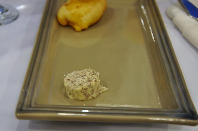 Burgos gamet butter with chorizo pepper jack roll