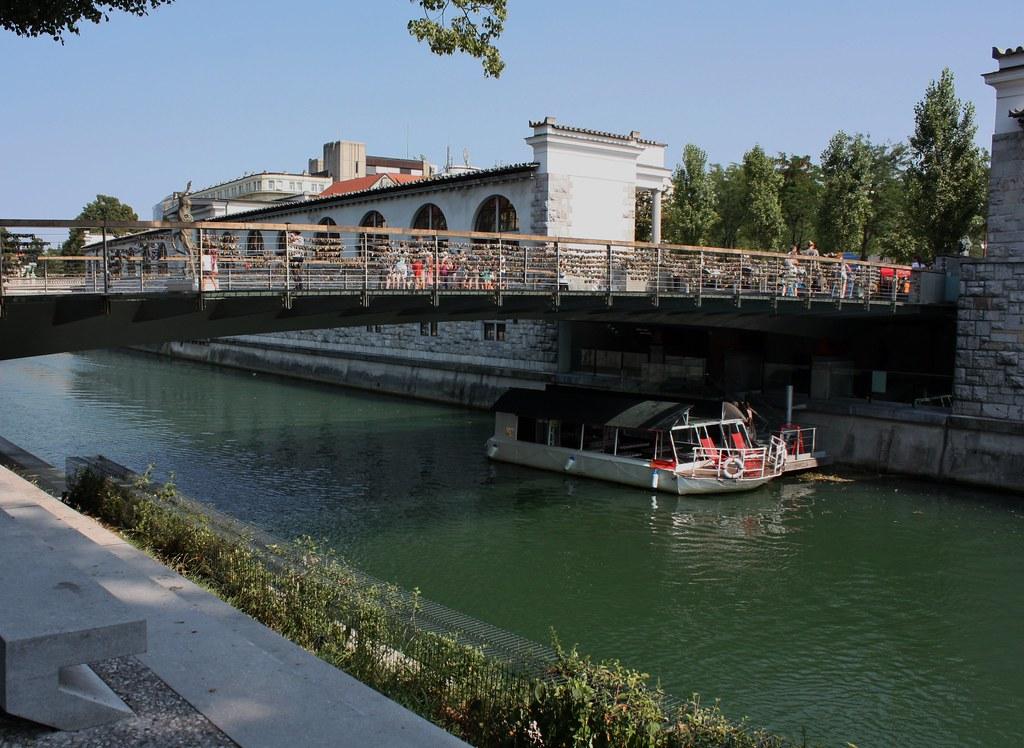 Boat under bridge in Ljubljana Slovenia