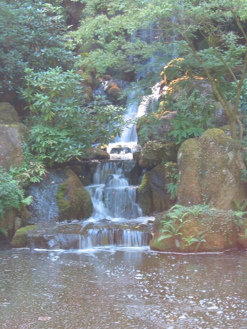 Waterfall Over A Large Koi Pond Flickr Photo Sharing