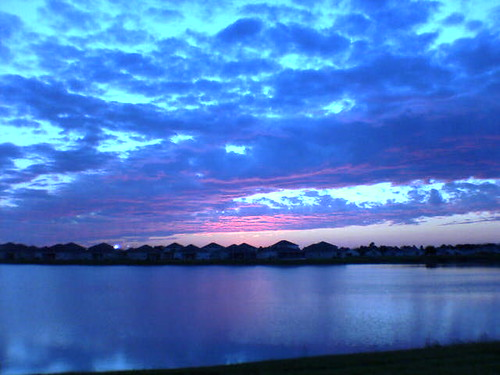 pink blue houses sunset sky lake water clouds evening pretty neighborhood