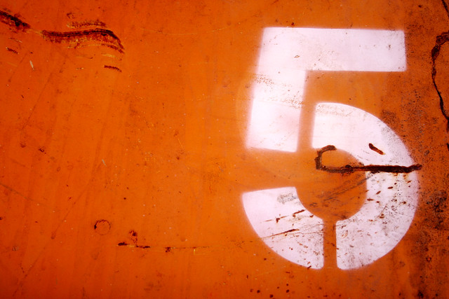 White 5 on Orange Dumpster