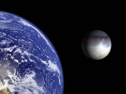 Earth and Triton to scale.