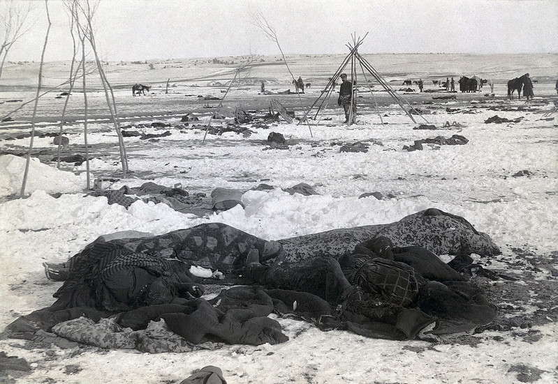 Big Foot's camp three weeks after Wounded Knee Massacre with bodies of four Lakota Sioux