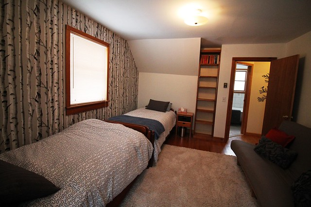 Guest bedroom with two twin beds and a double futon bed;