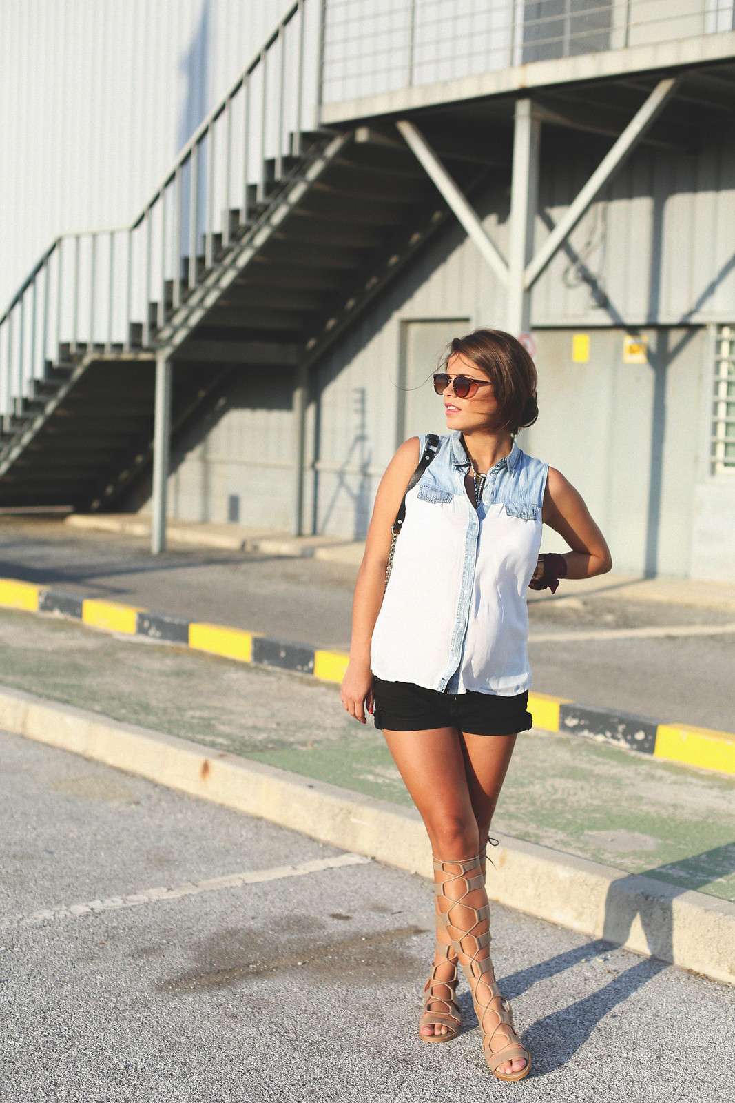 9. white denim vest black shorts sandals