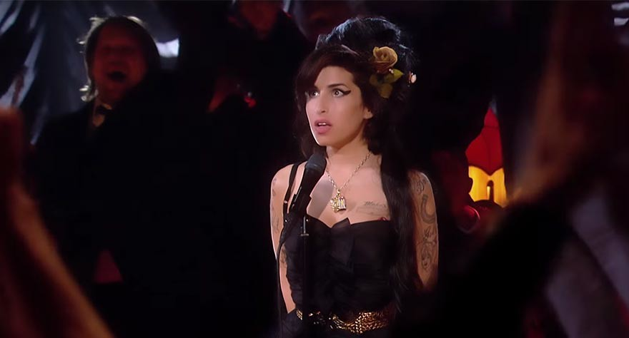 Amy Winehouse reacts to winning one of her five 2008 Grammy Awards in the otherwise tragic AMY.