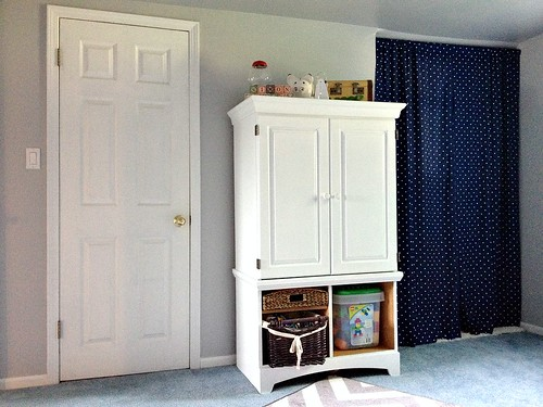 white hutch with patriotic curtains