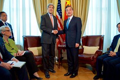 U.S. Secretary of State John Kerry shakes hands with Chinese Foreign Minister Wang Yi on July 2, 2015, in Vienna, Austria, before a bilateral meeting amid the P5+1 negotiations with Iranian officials about the future of their nuclear program. [State Department Photo / Public Domain]