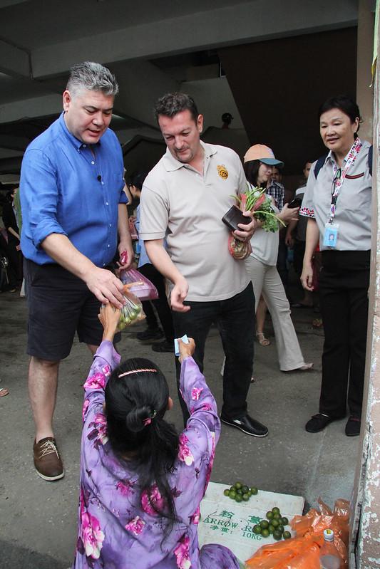 Jonathan Phang and Chef Yannis purchasing fresh limes from Kuala Kangsar Market