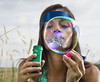 face of woman that blows soap bubbles by ssuaphoto