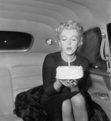 Marilyn Monroe blowing out candle