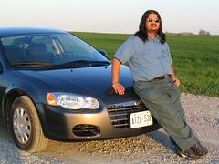 automobile(1.0), automotive exterior(1.0), executive car(1.0), vehicle(1.0), chrysler(1.0), bumper(1.0), land vehicle(1.0),