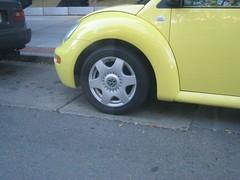 automobile(1.0), volkswagen beetle(1.0), automotive exterior(1.0), wheel(1.0), volkswagen(1.0), vehicle(1.0), volkswagen new beetle(1.0), rim(1.0), bumper(1.0), land vehicle(1.0),