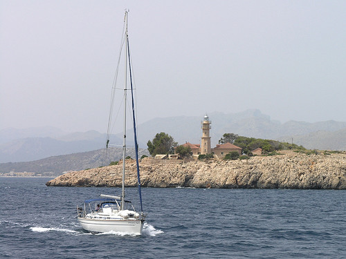 Mallorca- sailing boat passing the lighthouse